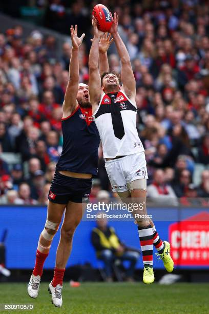Billy Longer of the Saints and Max Gawn of the Demons contest the ball during the round 21 AFL match between the Melbourne Demons and the St Kilda...