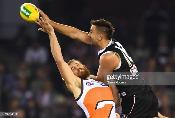 Billy Longer of the Saints and Shane Mumford of the Giants compete in the ruck during the round seven AFL match between the St Kilda Saints and the...