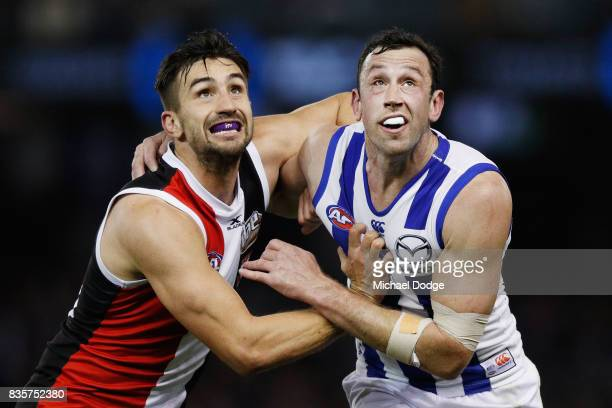 Billy Longer of the Saints and Todd Goldstein of the Kangaroos compete for the ball during the round 22 AFL match between the St Kilda Saints and the...
