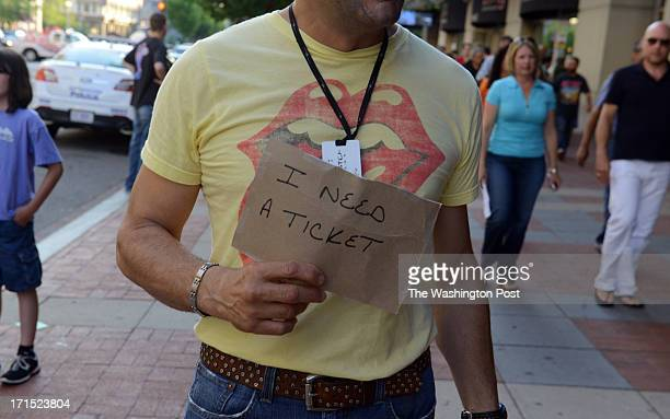 Billy Marra of Alexandria VA looks for a Rolling Stones concert ticket as concertgoers make their way into the Verizon Center to see the Rolling...