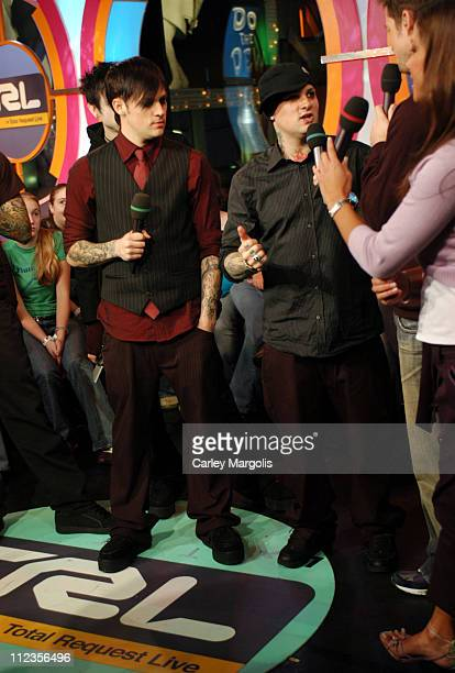 Billy Martin Joel Madden and Benji Madden of Good Charlotte with TRL VJs Damien Fahey and Vanessa Minnillo