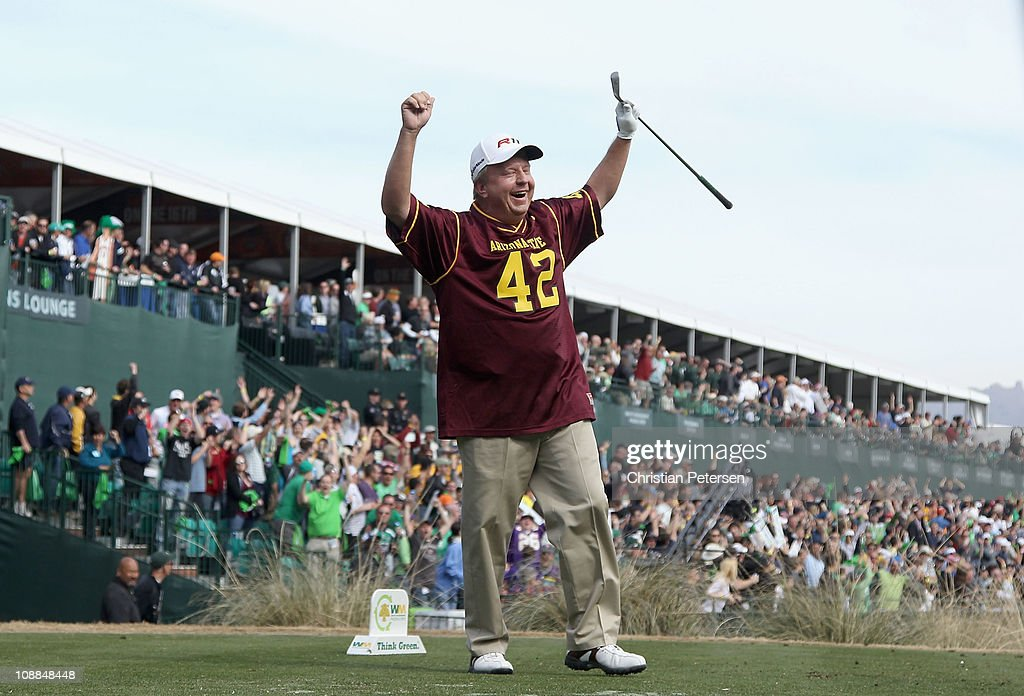 Billy Mayfair wearing a Pat Tillman ASU Sun Devils jersey celebrates after his tee shot on the 16th hole during the second round of the Waste...