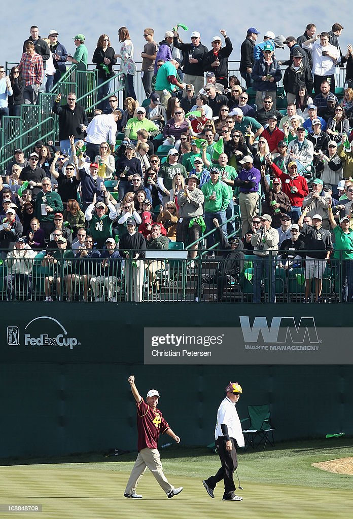 Billy Mayfair wearing a Pat Tillman ASU Sun Devils jersey waves to fans on the 16th hole during the second round of the Waste Management Phoenix Open...