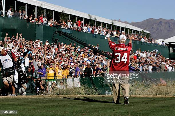 Billy Mayfair wearing an Arizona Cardinals jersey waves to the gallery on the 16th green during the second round of the FBR Phoenix Open held at TPC...