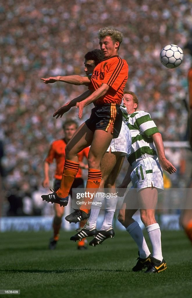 Billy McKinlay (centre) of Dundee United jumps for the ball during the Scottish Cup Final against Celtic at Hampden Park in Glasgow, Scotland. Celtic won the match 2-1. \ Mandatory Credit: Allsport UK /Allsport