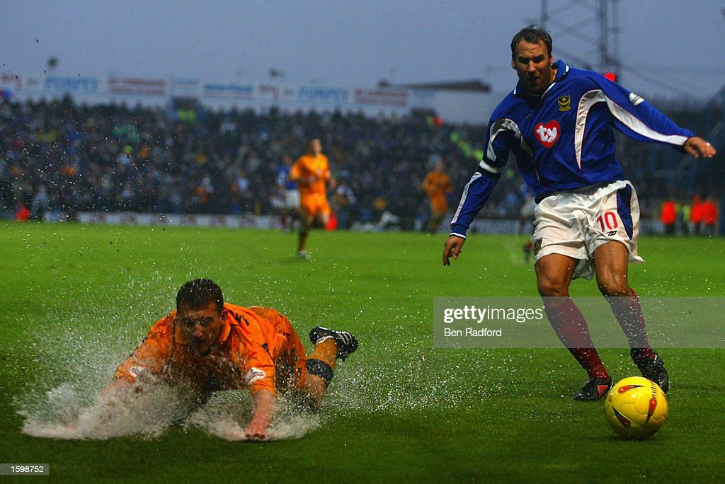 Billy McKinlay of Leicester City is sent flying by the tackle of Paul Merson of Portsmouth during the Nationwide League Division One match held on November 2, 2002 at Fratton Park, in Portsmouth, England. Leicester City won the match 2-0. DIGITAL IMAGE.