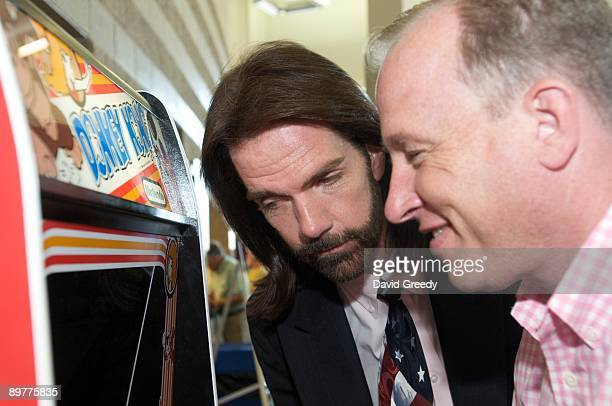 Billy Mitchell the 'Video Game Player of the Century' watches Steve Sanders 'The Orignal King of Kong' play Donkey Kong at the launch party for the...