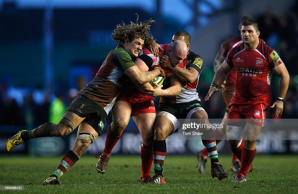 Billy Moss of London Welsh is tackled during the LV= Cup match between Harlequins and London Welsh at Twickenham Stoop on January 26, 2013 in London, England.