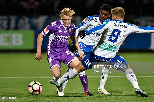 Billy Nordstrom of IFK Goteborg Tesfaldet Tekie of IFK Norrkoping and Nicklas Barkroth of IFK Norrkoping during the allsvenskan match between IFK...