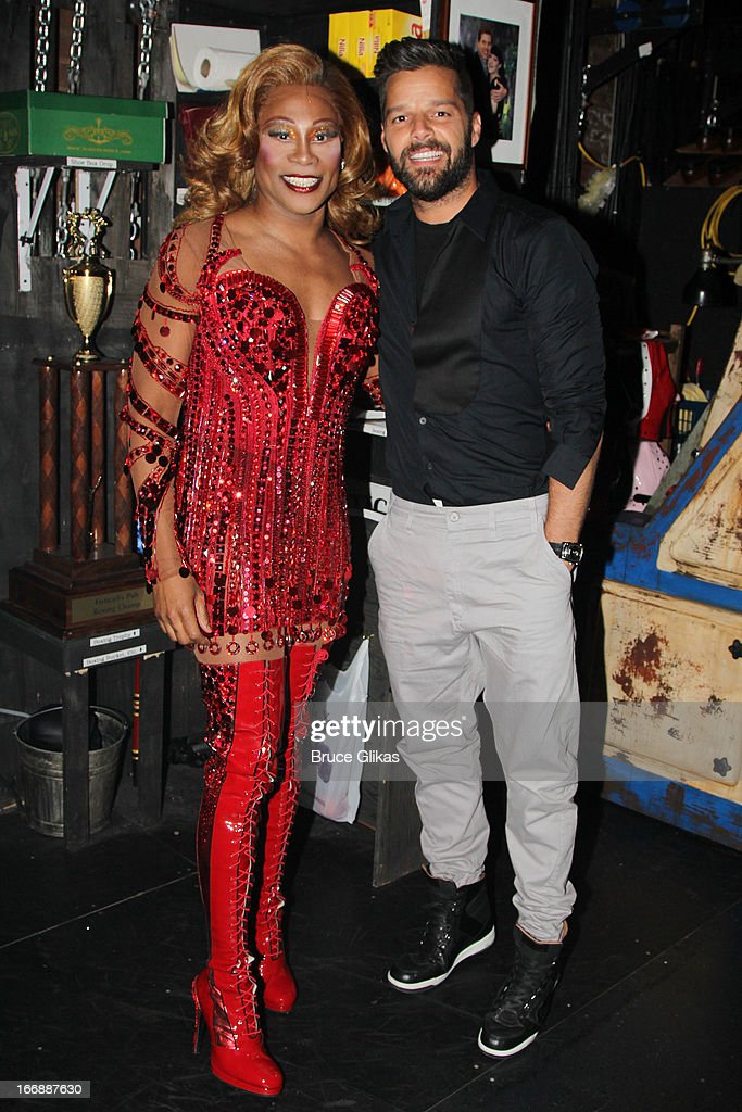 Billy Porter as 'Lola' and Ricky Martin pose backstage at the hit musical 'Kinky Boots' on Broadway at The Al Hirshfeld Theater on April 17, 2013 in New York City.