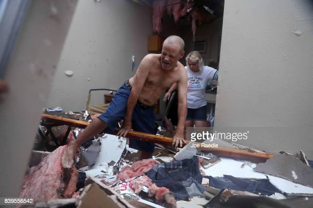 Billy Raney and Donna Raney climb over the wreckage of whats left of their apartment after Hurricane Harvey destroyed it on August 26 2017 in...