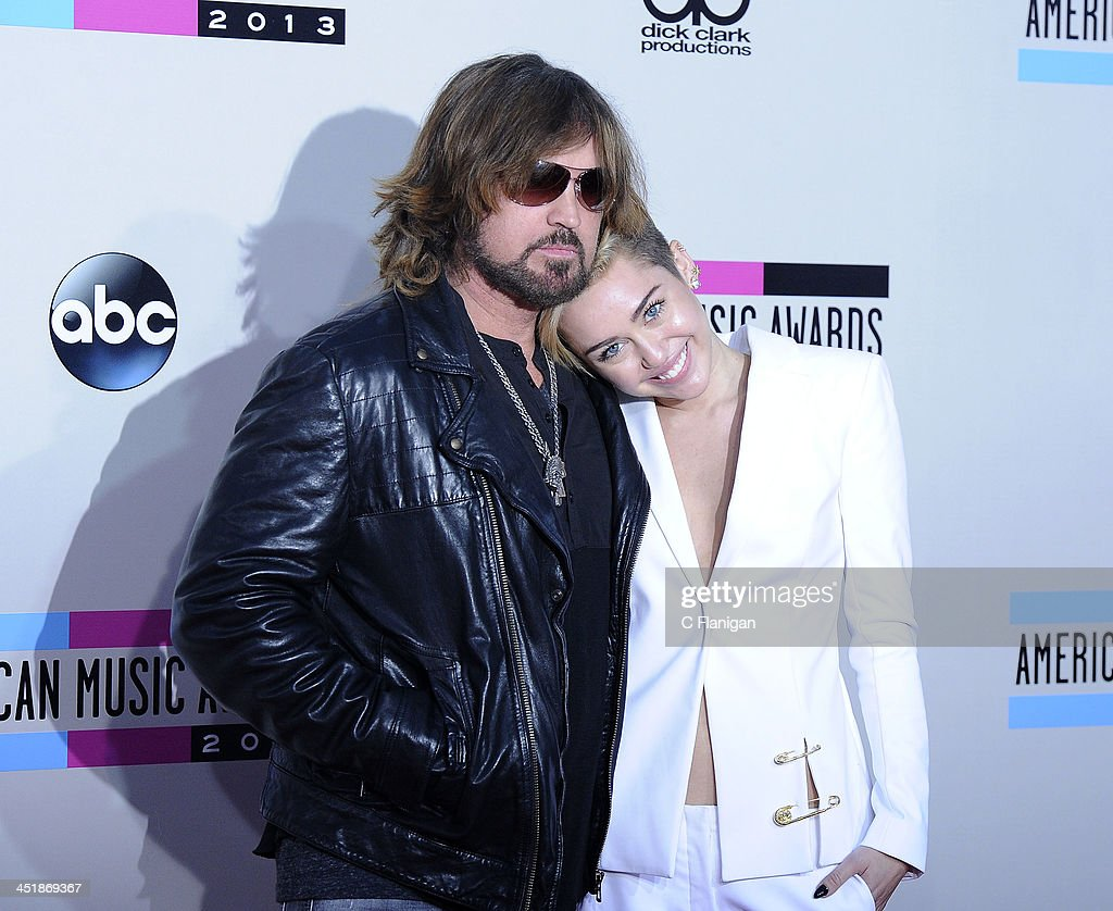 <a gi-track='captionPersonalityLinkClicked' href=/galleries/search?phrase=Billy+Ray+Cyrus&family=editorial&specificpeople=213601 ng-click='$event.stopPropagation()'>Billy Ray Cyrus</a> and daughter <a gi-track='captionPersonalityLinkClicked' href=/galleries/search?phrase=Miley+Cyrus&family=editorial&specificpeople=3973523 ng-click='$event.stopPropagation()'>Miley Cyrus</a> arrive at the 2013 American Music Awards at Nokia Theatre L.A. Live on November 24, 2013 in Los Angeles, California.