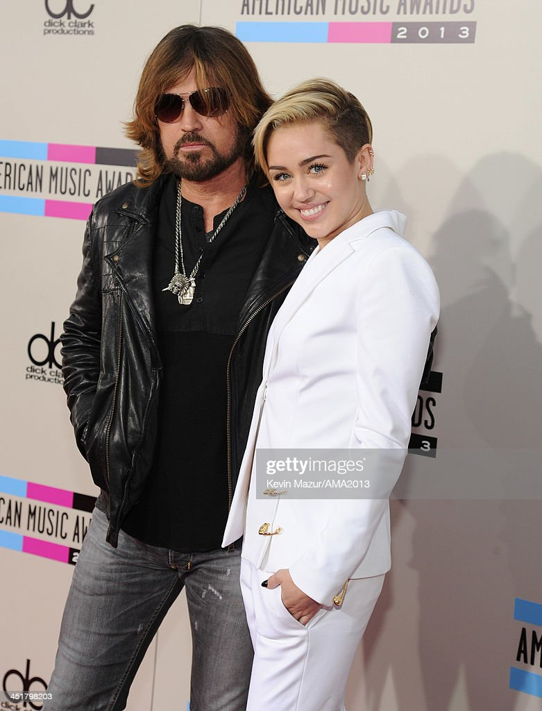 <a gi-track='captionPersonalityLinkClicked' href=/galleries/search?phrase=Billy+Ray+Cyrus&family=editorial&specificpeople=213601 ng-click='$event.stopPropagation()'>Billy Ray Cyrus</a> and <a gi-track='captionPersonalityLinkClicked' href=/galleries/search?phrase=Miley+Cyrus&family=editorial&specificpeople=3973523 ng-click='$event.stopPropagation()'>Miley Cyrus</a> attend the 2013 American Music Awards at Nokia Theatre L.A. Live on November 24, 2013 in Los Angeles, California.