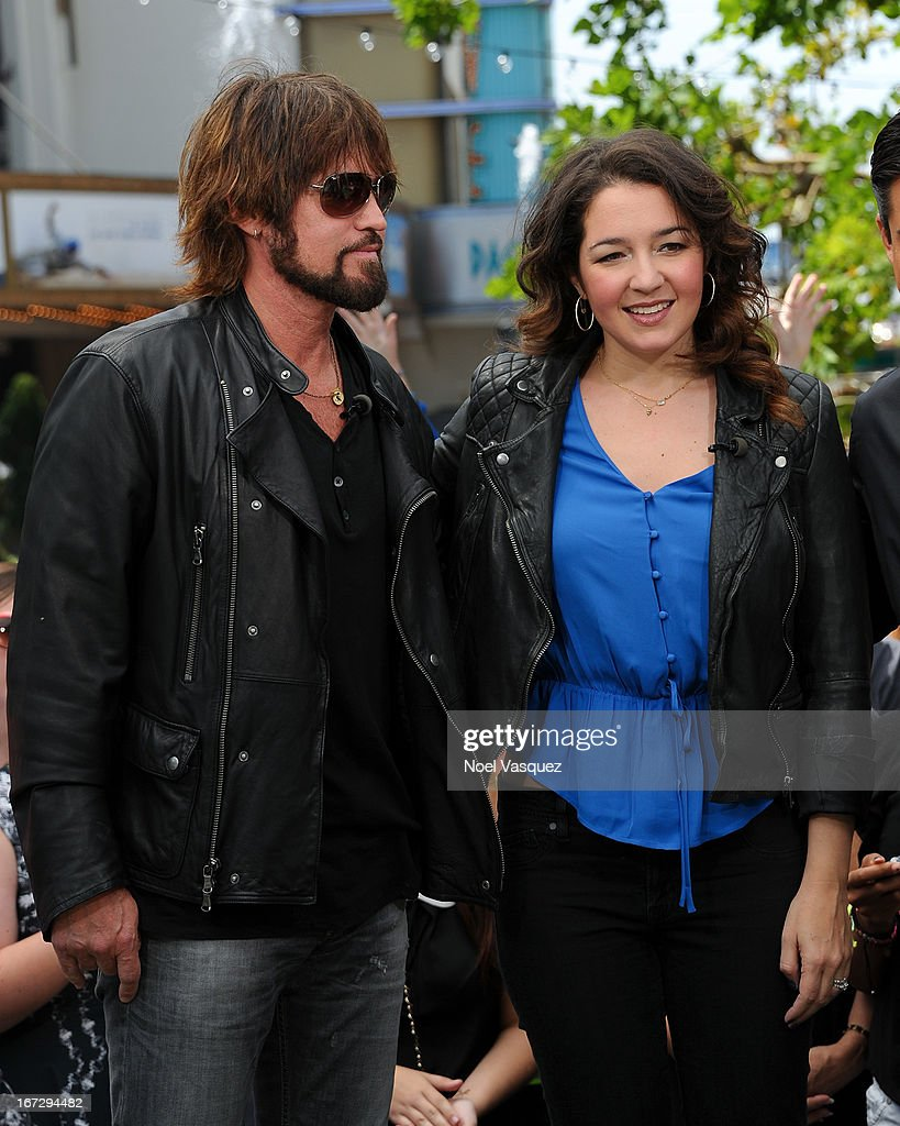 Billy Ray Cyrus (L) and Sara Mann visit 'Extra' at The Grove on April 23, 2013 in Los Angeles, California.