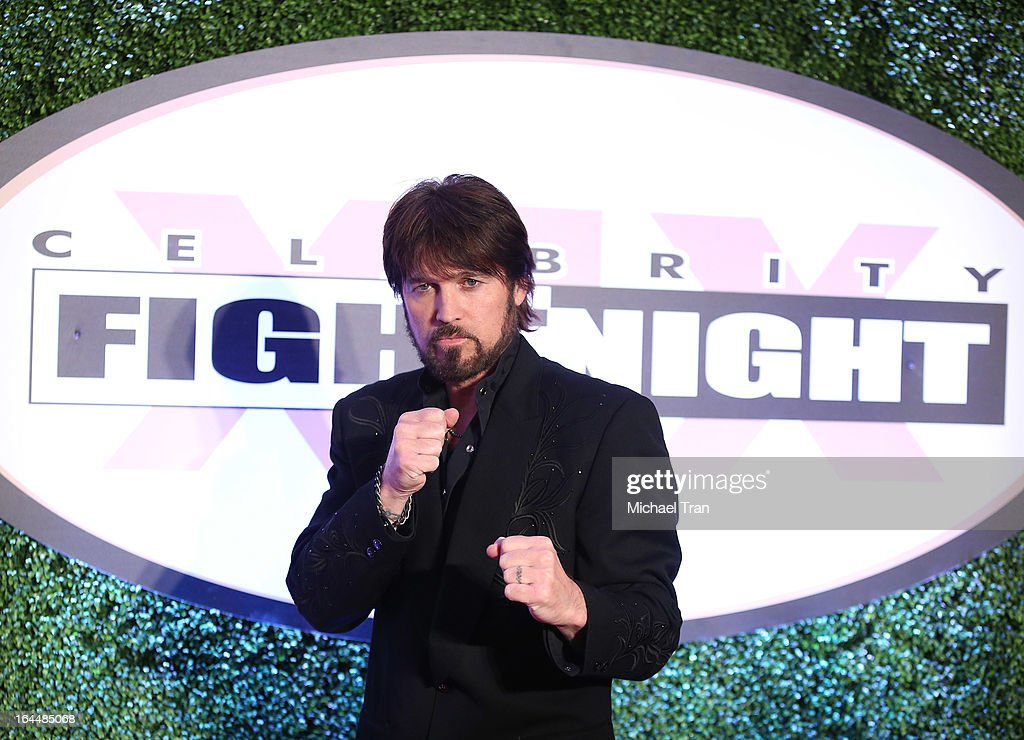 <a gi-track='captionPersonalityLinkClicked' href=/galleries/search?phrase=Billy+Ray+Cyrus&family=editorial&specificpeople=213601 ng-click='$event.stopPropagation()'>Billy Ray Cyrus</a> arrives at Celebrity Fight Night XIX held at JW Marriott Desert Ridge Resort & Spa on March 23, 2013 in Phoenix, Arizona.