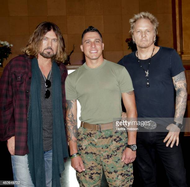 Billy Ray Cyrus Mark Plummer and Matt Sorum attend the filming of the 'Do What I Do' music video on July 24 2014 in Los Angeles California