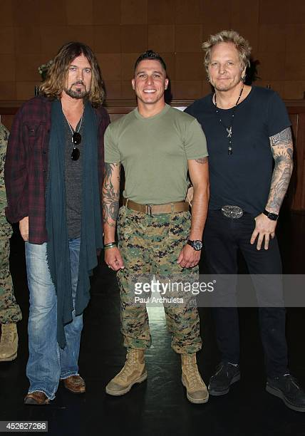 Billy Ray Cyrus Mark Plummer and Matt Sorum pose for pictures at the filming of 'Do What I Do' video shoot on July 24 2014 in Los Angeles California