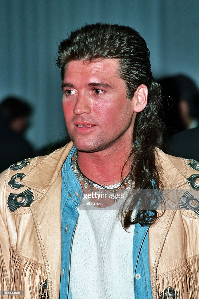 Billy Ray Cyrus possibly the king of the mullet? 1993 version seen here at a record company party