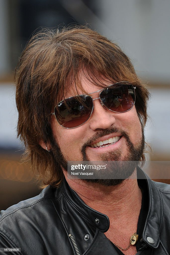 <a gi-track='captionPersonalityLinkClicked' href=/galleries/search?phrase=Billy+Ray+Cyrus&family=editorial&specificpeople=213601 ng-click='$event.stopPropagation()'>Billy Ray Cyrus</a> visits 'Extra' at The Grove on April 23, 2013 in Los Angeles, California.
