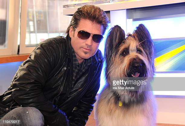 AMERICA Billy Ray Cyrus wanted to get his photo taken with Norman the scooterriding Briard dog from Georgia after a taping for GOOD MORNING AMERICA...