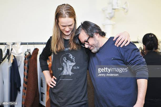 Billy Reid and a model prepare backstage at the Billy Reid Men's show during the MercedesBenz Fashion Week Fall 2015 at The Bowery Hotel on February...