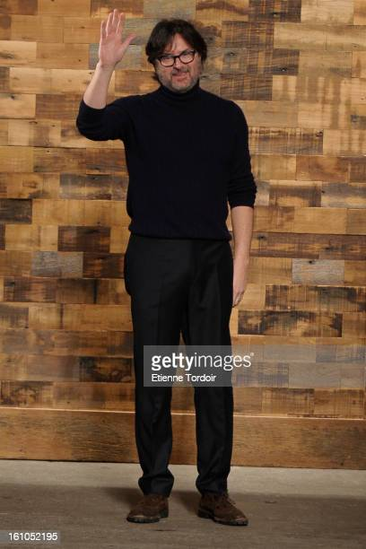Billy Reid salutes the audience at the end of his show during Fall 2013 MercedesBenz Fashion Week at Eyebeam Studio on February 8 2013 in New York...
