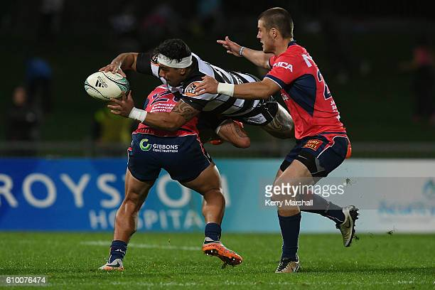 Billy Rohipa of Hawke's Bay gets a pass away in a tackle during the round six Mitre 10 Cup match between the Hawke's Bay and Tasman at McLean Park on...