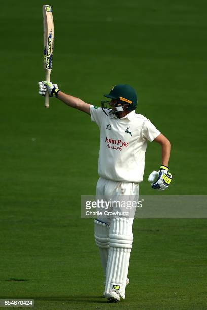 Billy Root of Nottinghamshire celebrates his century during day three of the Specsavers County Championship Division Two match between Sussex and...