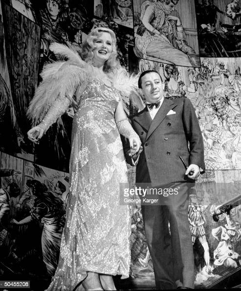 Billy Rose Showgirl Ann Mace standing with Billy Rose
