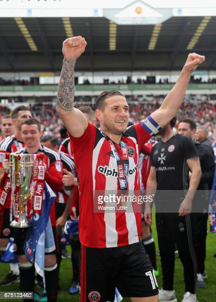 Billy Sharp Captain of Sheffield United celebrate after winning promotion into next seasons Sky Bet Championship after the Sky Bet League One match...