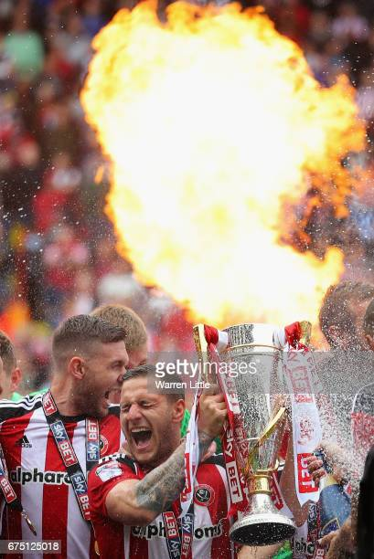 Billy Sharp Captain of Sheffield United raises the Sky Bet League One trophy and celebrates winning promotion into next seasons Sky Bet Championship...