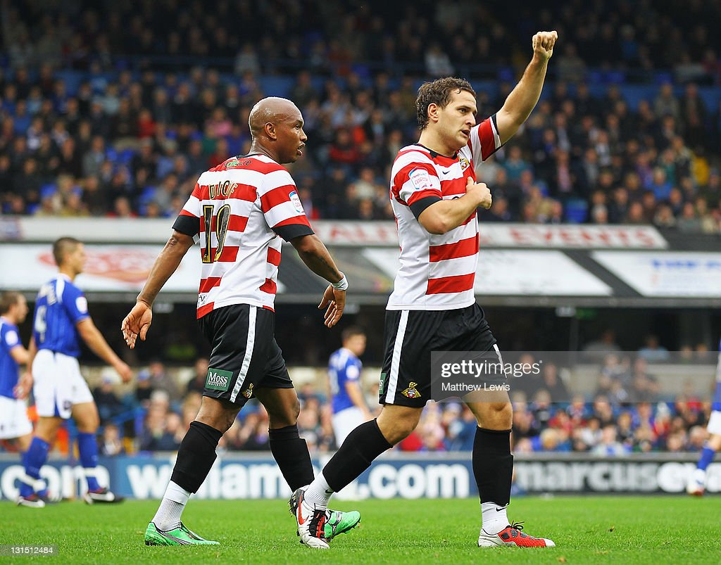 Billy Sharp of Doncaster celebrates his goal with <a gi-track='captionPersonalityLinkClicked' href=/galleries/search?phrase=El-Hadji+Diouf&family=editorial&specificpeople=204332 ng-click='$event.stopPropagation()'>El-Hadji Diouf</a> during the npower Championship match between Ipswich Town and Doncaster Rovers at Portman Road on November 5, 2011 in Ipswich, England.