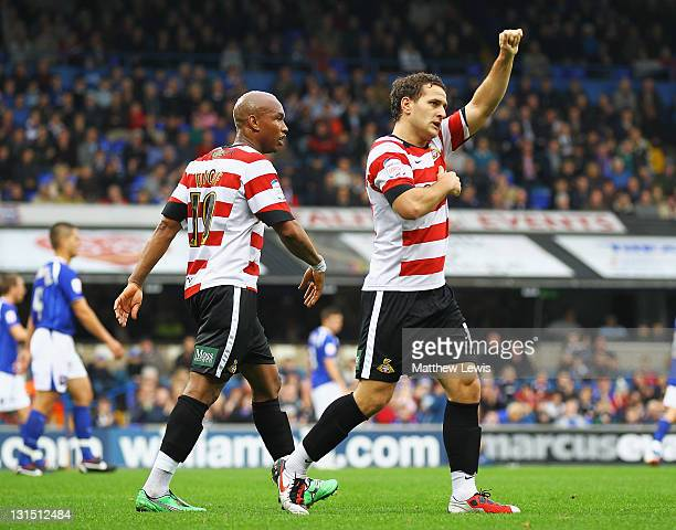 Billy Sharp of Doncaster celebrates his goal with ElHadji Diouf during the npower Championship match between Ipswich Town and Doncaster Rovers at...