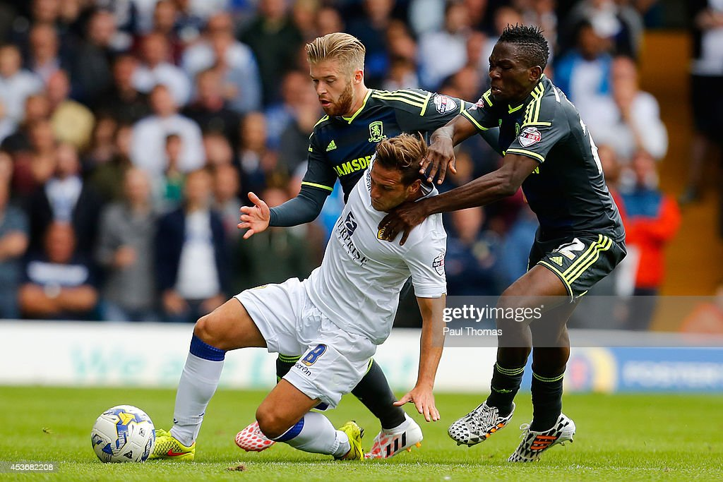 Billy Sharp (C) of Leeds in action with Adam Clayton (L) and Kenneth Omeruo of Middlesbrough during the Sky Bet Championship match between Leeds United and Middlesbrough at Elland Road on August 16, 2014 in Leeds, England.