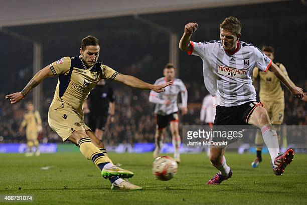 Billy Sharp of Leeds United is blocked by Michael Turner of Fulham during the Sky Bet Championship match between Fulham and Leeds United at Craven...