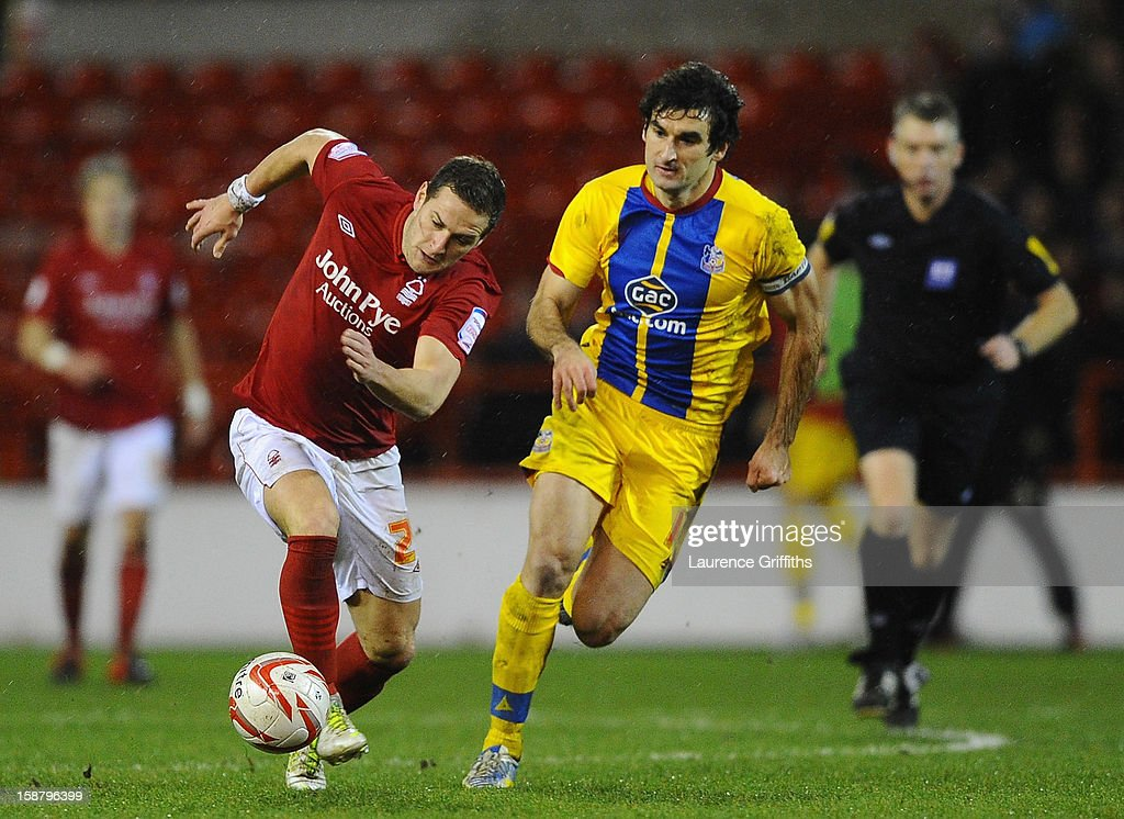 Billy Sharp of Nottingham Forest battles with Mile Jedinak of Crystal Palace during the npower Championship match between Nottingham Forest and Crystal Palace at City Ground on December 29, 2012 in Nottingham, England.