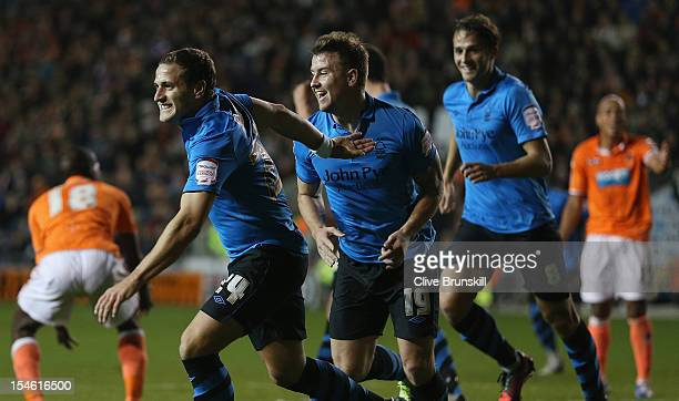 Billy Sharp of Nottingham Forest celebrates with team mates Simon Cox and Chris Cohen after scoring the first goal during the npower Championship...