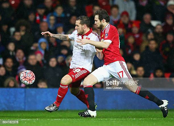 Billy Sharp of Sheffield United and Daley Blind of Manchester United compete for the ball during the Emirates FA Cup Third Round match between...