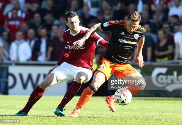 Billy Sharp of Sheffield United attempts to control the ball watched by Zander Diamond of Northampton Town during the Sky Bet League One match...
