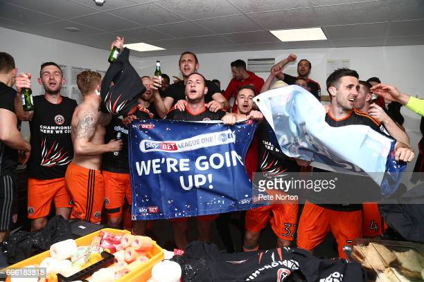 Billy Sharp of Sheffield United celebrates after promotion to the Championship after the Sky Bet League One match between Northampton Town and...