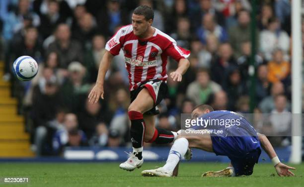 Billy Sharp of Sheffield United jumps a tackle from Stuart Parnaby of Birmingham during the CocaCola Championship match between Birmingham City and...