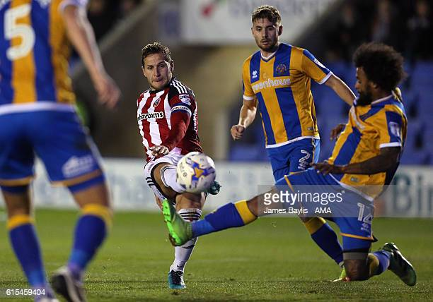 Billy Sharp of Sheffield United shoots at goal during the Sky Bet League One match between Shrewsbury Town and Sheffield United at Greenhous Meadow...