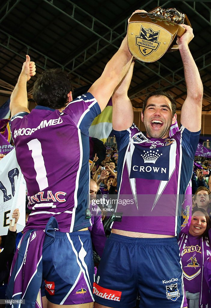 <a gi-track='captionPersonalityLinkClicked' href=/galleries/search?phrase=Billy+Slater&family=editorial&specificpeople=171206 ng-click='$event.stopPropagation()'>Billy Slater</a> and <a gi-track='captionPersonalityLinkClicked' href=/galleries/search?phrase=Cameron+Smith+-+Rugby+League+Player&family=editorial&specificpeople=453295 ng-click='$event.stopPropagation()'>Cameron Smith</a> of Storm celebrate with the trophy during the lap of honour after winning the 2012 NRL Grand Final match between the Melbourne Storm and the Canterbury Bulldogs at ANZ Stadium on September 30, 2012 in Sydney, Australia.