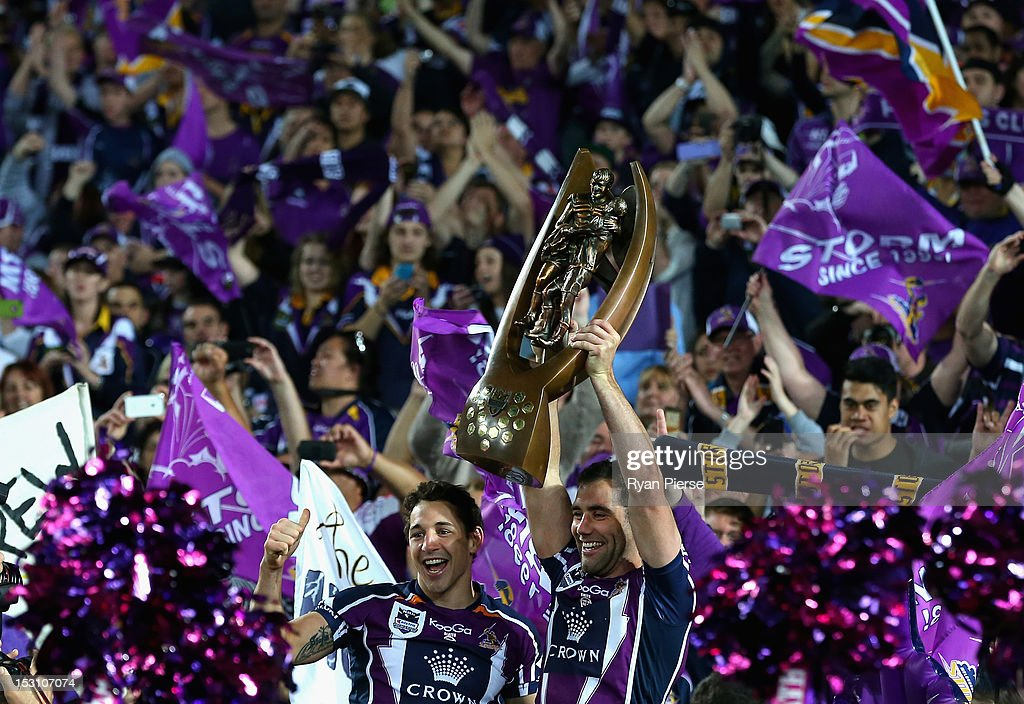 <a gi-track='captionPersonalityLinkClicked' href=/galleries/search?phrase=Billy+Slater&family=editorial&specificpeople=171206 ng-click='$event.stopPropagation()'>Billy Slater</a> and <a gi-track='captionPersonalityLinkClicked' href=/galleries/search?phrase=Cameron+Smith+-+Rugby+League+Player&family=editorial&specificpeople=453295 ng-click='$event.stopPropagation()'>Cameron Smith</a> of the Storm celebrate with the Premiership Trophy after the 2012 NRL Grand Final match between the Melbourne Storm and the Canterbury Bulldogs at ANZ Stadium on September 30, 2012 in Sydney, Australia.