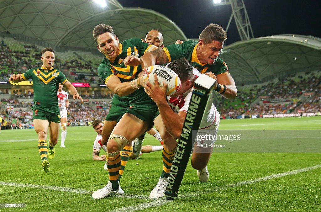 Billy Slater and Dane Gagai of the Kangaroos perform a try saving tackle as Ryan Hall of England attempts to score a try in the corner during the 2017 Rugby League World Cup match between the Australian Kangaroos and England at AAMI Park on October 27, 2017 in Melbourne, Australia.