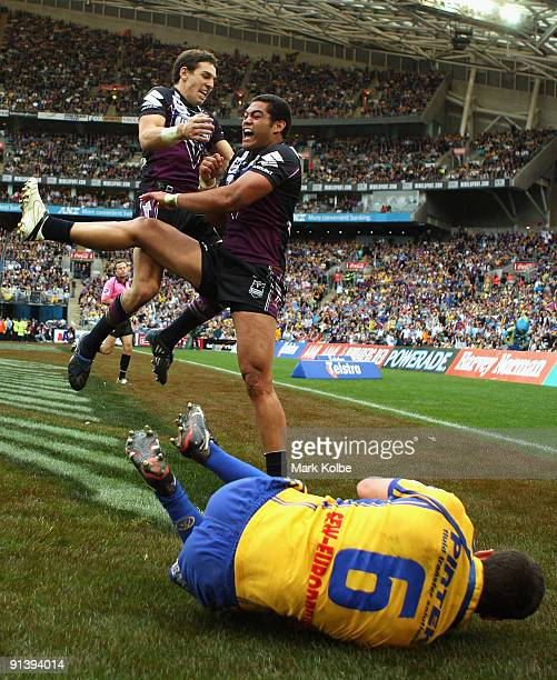 Billy Slater celebrates with Adam Blair of the Storm after he scored the second Storm try during the 2009 NRL Grand Final match between the...