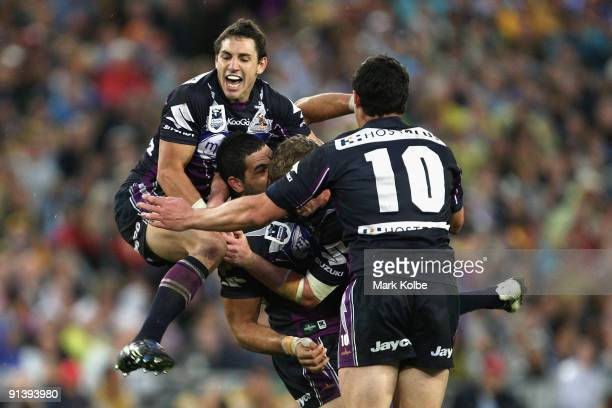 Billy Slater celebrates with Greg Inglis of the Storm after he kicked a field goal during the 2009 NRL Grand Final match between the Parramatta Eels...