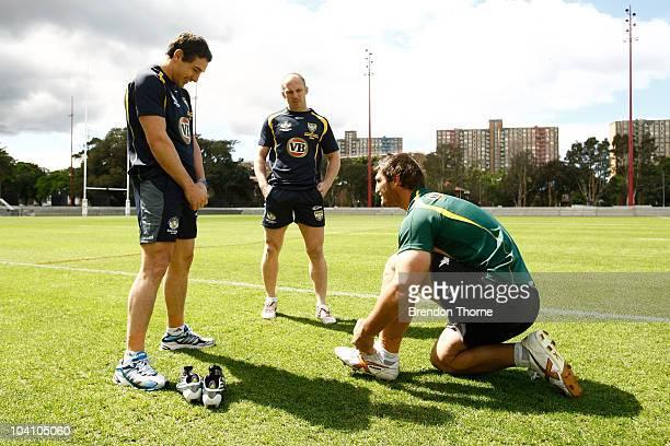 Billy Slater Darren Lockyer and David Taylor talk during an Australian Kangaroos ARL training session at Redfern Oval on September 15 2010 in Sydney...
