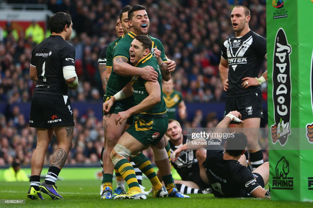 Billy Slater of Australia celebrates scoring his sides opening try with Andrew Fifita during the Rugby League World Cup Final between Australia and...