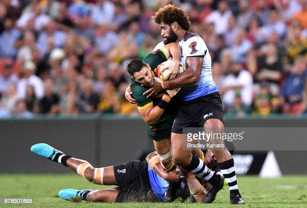 Billy Slater of Australia is tackled during the 2017 Rugby League World Cup Semi Final match between the Australian Kangaroos and Fiji at Suncorp...